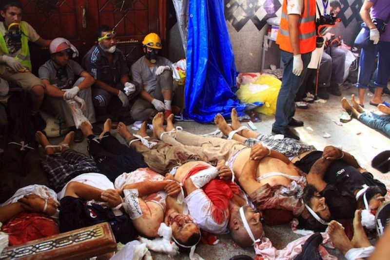 Dead bodies of members of the Muslim Brotherhood and supporters of deposed Egyptian President Mohamed Mursi lie in a room in a field hospital at the Rabaa Adawiya mosque in Cairo, Egypt on August 14, 2013. Security forces launched a crackdown on the protest camps that quickly turned into a bloodbath with dozens dead. A state of emergency has been declared.