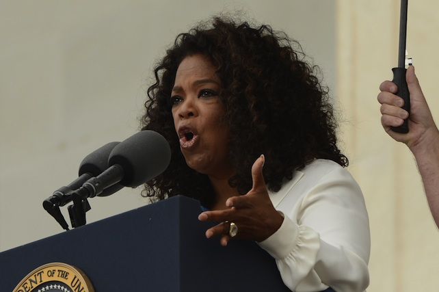 Oprah Winfrey (L) delivers remarks during the 'Let Freedom Ring' commemoration