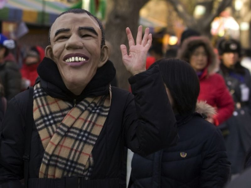 A Chinese woman wears a U.S. President Barack Obama face mask at a temple fair in Beijing January 27, 2009.